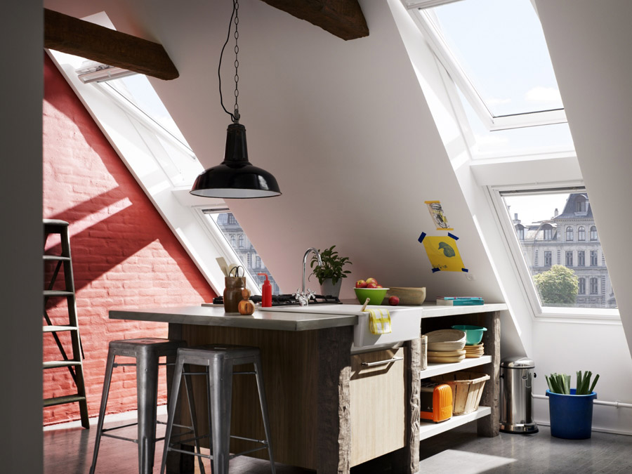 Kitchen loft conversion using VELUX centre pivot roof windows